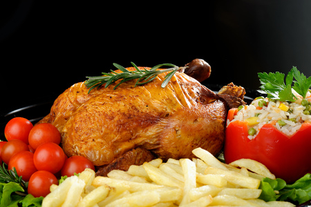scrumptious: Whole roasted chicken with vegetables and rosemary Stock Photo