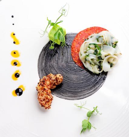 Haute cuisine Gourmet appetizer squid shrimp tempura and Chorizo