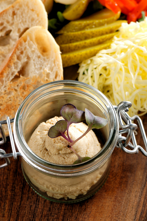 canard: Canard Foie gras Pate made of the liver of a duck or goose with toasted bread slices
