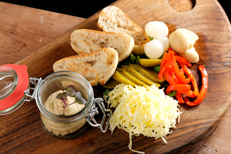 sauternes: Rustic breakfast. sandwich with liver pate, spring vegetables - radishes, green onions, cucumbers and butter Stock Photo