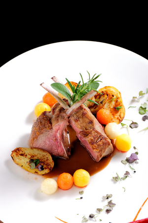 dining table: Fine dining, roasted Lamb chops with potato, rosemary and vegetable sauce
