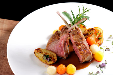 Fine dining, roasted Lamb chops with potato, rosemary and vegetable sauce