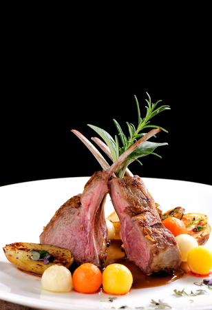 the lamb: Fine dining, roasted Lamb chops with potato, rosemary and vegetable sauce