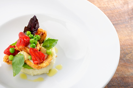 fine fish: Fine dining, Fried Octopus on potato purree, green peas and fresh strawberries