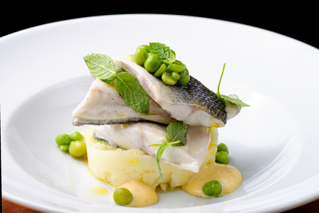 Seabass fillet with vegetable and mashed potato Standard-Bild