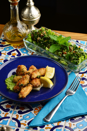 tabbouleh: Arabic  Lebanese style chicken wings glazed with a lemon and tabbouleh salad Stock Photo