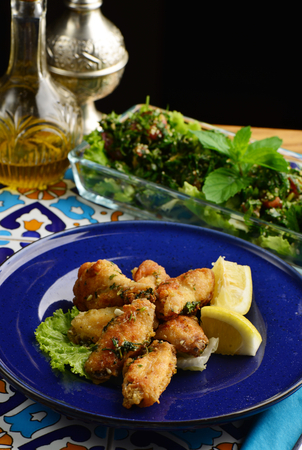 shishkabab: Arabic  Lebanese style chicken wings glazed with a lemon and tabbouleh salad Stock Photo