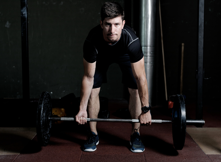 well build: Athlete Fitness trainer working out  weight lifting in a gym Stock Photo