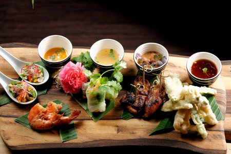 fried shrimp: Asian Fusion appetizer plate, with Tempura, Shrimps, Spring rolls and spicy chicken Stock Photo