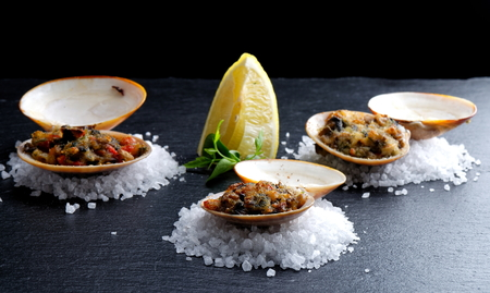 coquille: Haute cousine, baked clam mussels au gratin on the salt crystals with olive oil