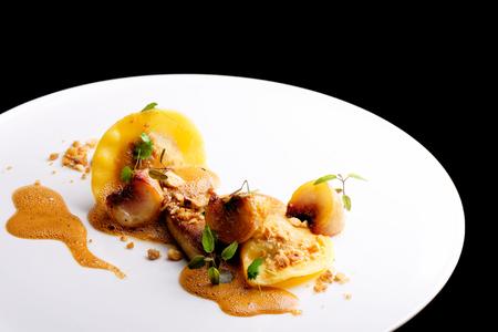 haute cuisine: Haute cuisine, roasted Foie gras with homemade ravioli and apples Stock Photo