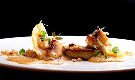 Haute cuisine, roasted Foie gras with homemade ravioli and apples Standard-Bild
