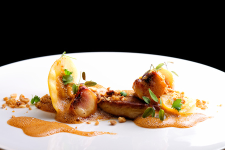 Haute cuisine, roasted Foie gras with homemade ravioli and apples Stock Photo