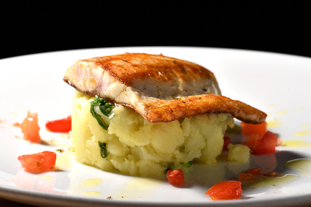 red cooked: Tasty healthy fish fillet with potato and vegetables
