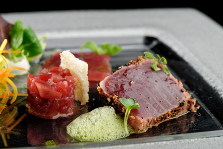 haute cuisine: Tuna sashimi, tuna tartare and Wasabi sauce. Haute cuisine Stock Photo