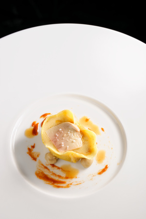 Fine dining ravioli with Foie gras Imagens