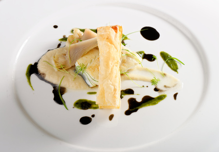 sauce dish: Fine dining, baked cod fillet with spinach sauce and roasted onions