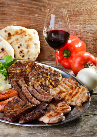 meat grill: Wholesome platter of mixed meats including grilled steak. Balkan food Stock Photo