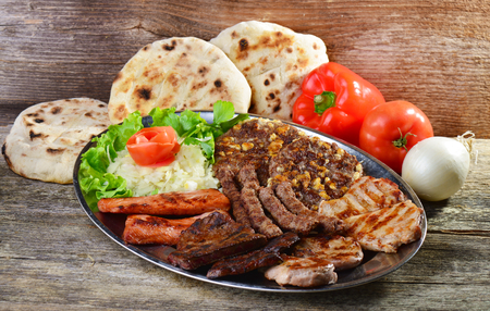 Wholesome platter of mixed meats including grilled steak. Balkan food Standard-Bild