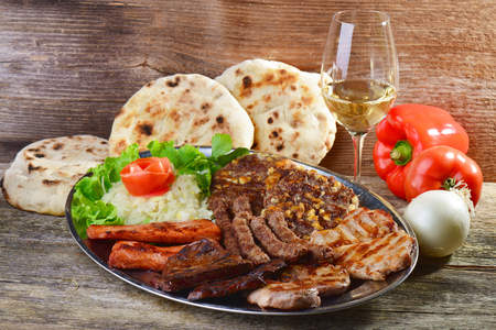 wholesome: Wholesome platter of mixed meats including grilled steak. Balkan food Stock Photo