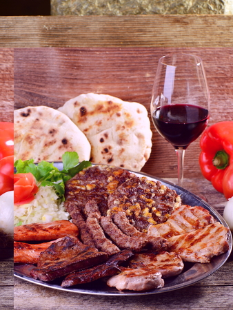 griller: Wholesome platter of mixed meats including grilled steak. Balkan food Stock Photo