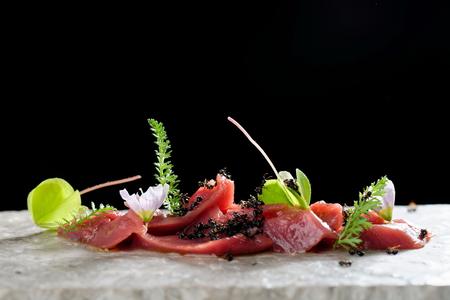 haute cuisine: Haute cuisine, venison meat carpaccio with ants