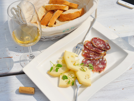 charcuter�a: Cheese and cured meat charcuterie selection salam Foto de archivo