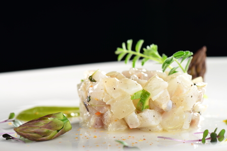 fine fish: Fine dining appetizer, fish tartare with asparagus Stock Photo