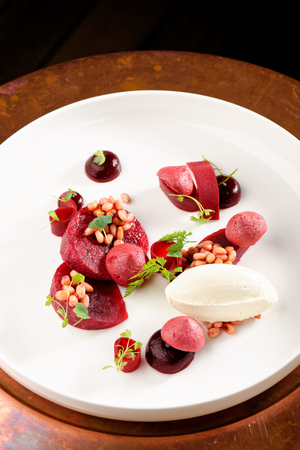 Fine dining dessert, Beetroot, cherry Parfait, ice cream, white chocolate mousse and spices
