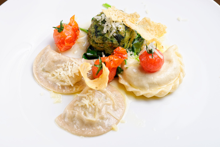 regional: Bavarian breadpotato dumplings served on a white platter, garnished with parsley  and cheese