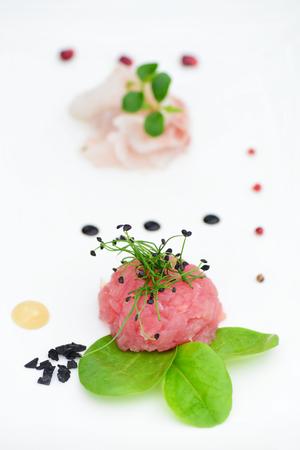 tuna tartar with fresh salad and lemon slice Stock Photo