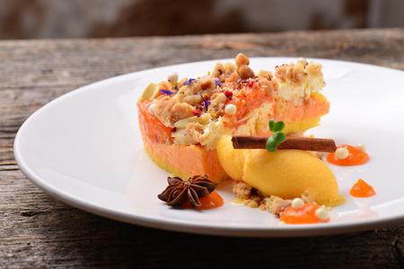 Pumpkin cheesecake with caramel and homemade ice cream Stock Photo