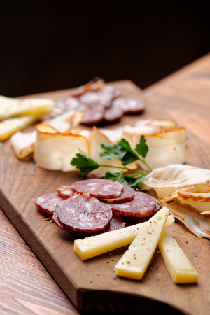 Cheese and cured meat charcuterie selection salami Stock Photo