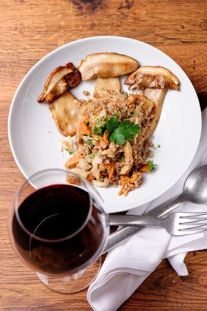 Barley risotto with Porcini mushrooms Stock Photo