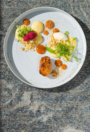 Fine dining dessert, Apricot Parfait, ice cream, white chocolate mousse and spices