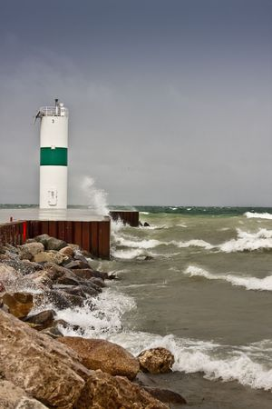 Pierhead on Lake Michigan to guide ships down channel into Pentwater Lake. Stock Photo