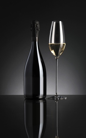 cristmas: sparkling wine on dark background