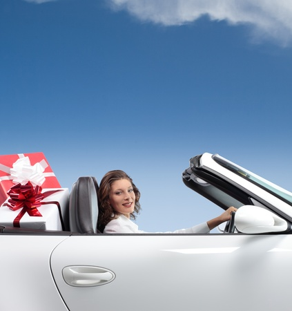young woman, shopping , driving convertible car , gift box Stock Photo - 10951618