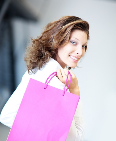 smiling Woman holding shopping bags photo