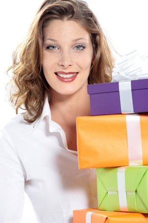 portrait of attractive young woman with gift pack, white background photo