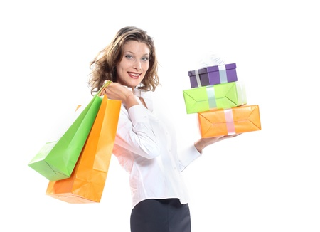 smiling Woman holding shopping bags and gift box against a white background  Stock Photo - 10951494