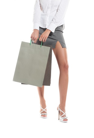 sexy legs of a woman with shopping bags, white background photo