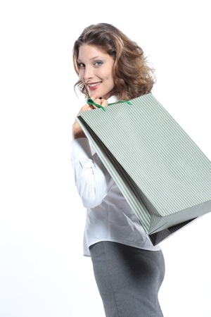 Woman holding shopping bags against a white background  photo