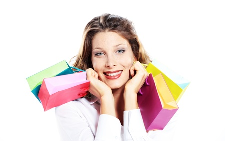 Beautiful shopping woman holding colorful bags, smiling, white background  photo