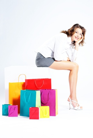 Woman holding shopping bags against a white background Stock Photo - 10951527