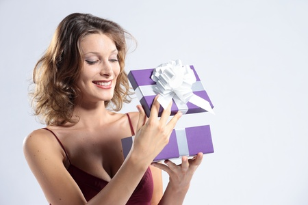 open gift: Surprised attractive woman open gift box Stock Photo