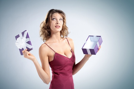 attractive woman open gift box photo