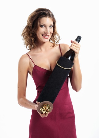 wine gift: young attractive woman with a bottle of sparkling wine, gift box