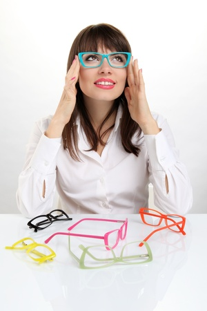 hilarity: pretty girl wearing colored glasses Stock Photo