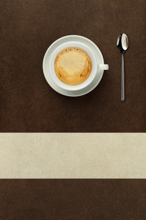cup of coffee on the table with spoon photo